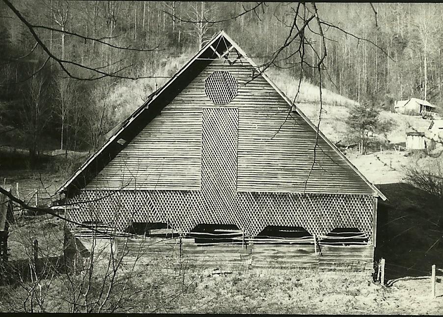 Masonic Grand Geometer symbol shown in gable peak in historic picture
